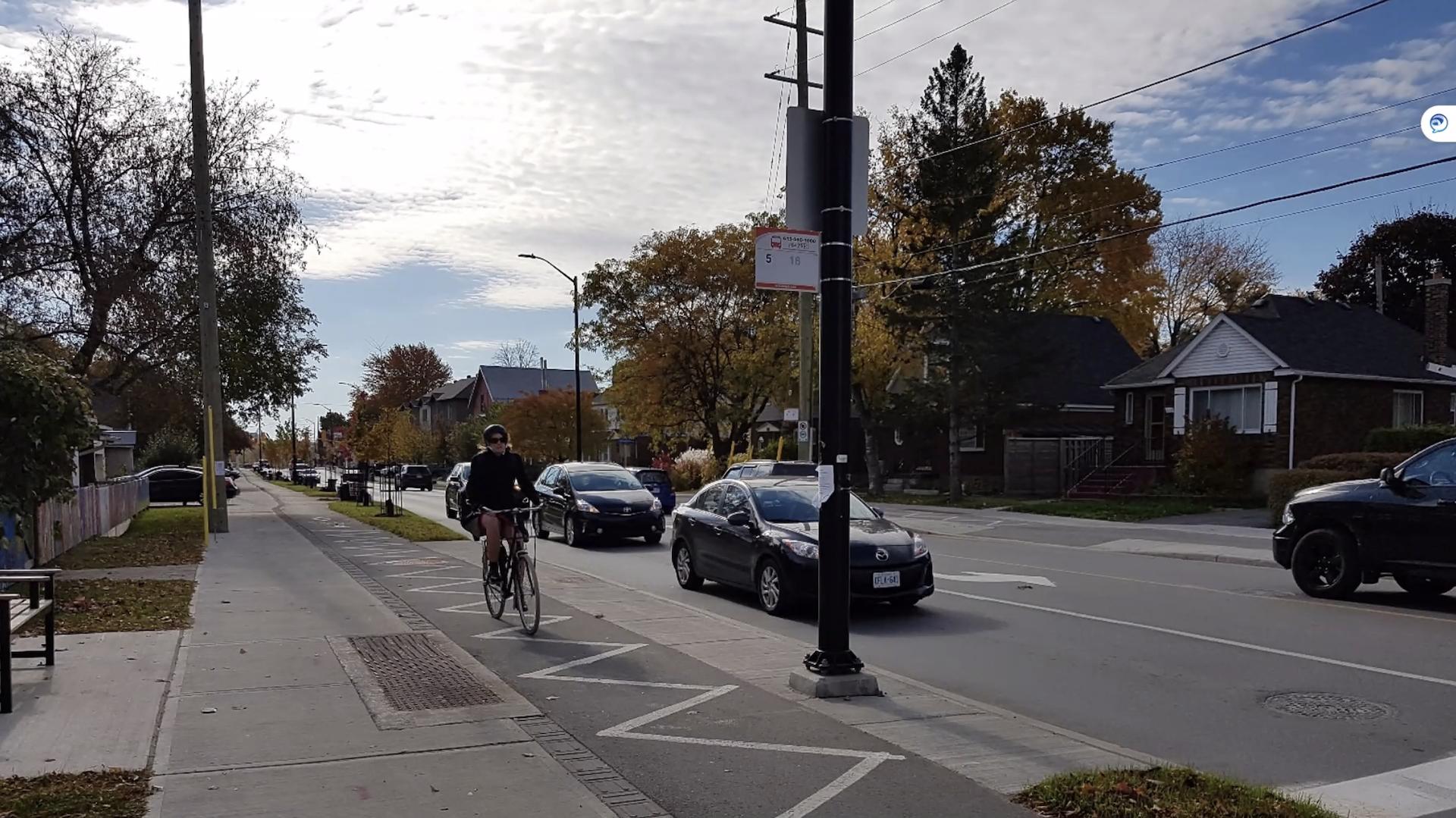 A person riding a bike on a separate bike lane in Ottawa.