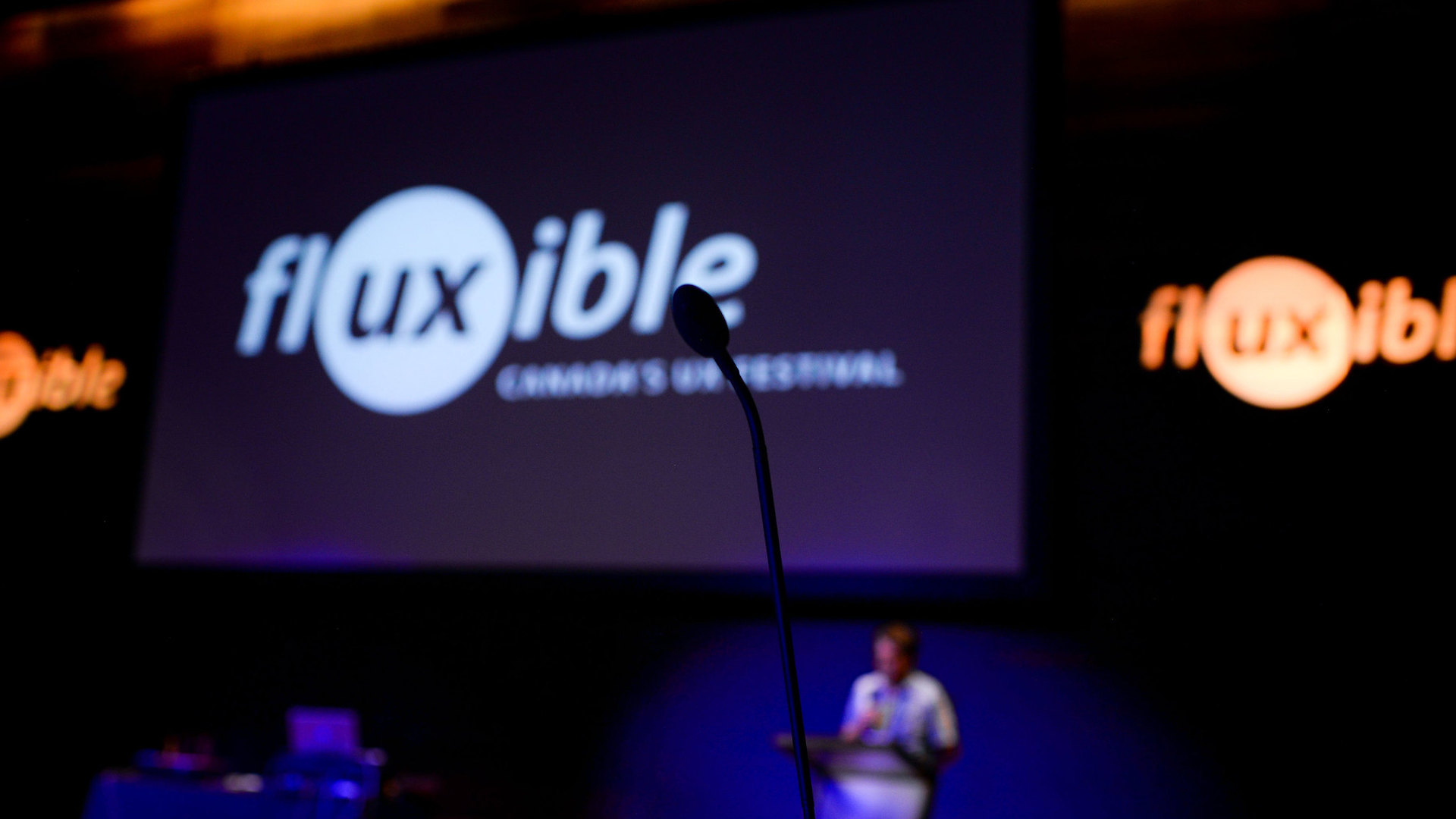 A mic with the Fluxible logo on a screen.