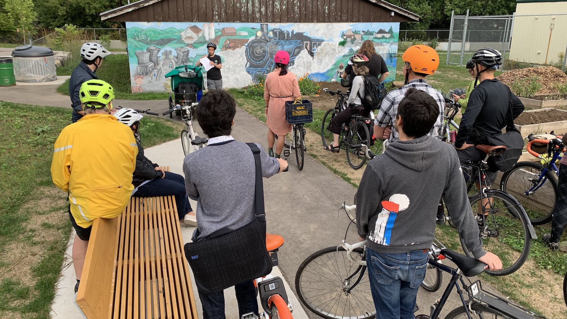 Darren Kropf speaks to participants of the Fluxible Guided Bike Tour about the Spur Line trail.