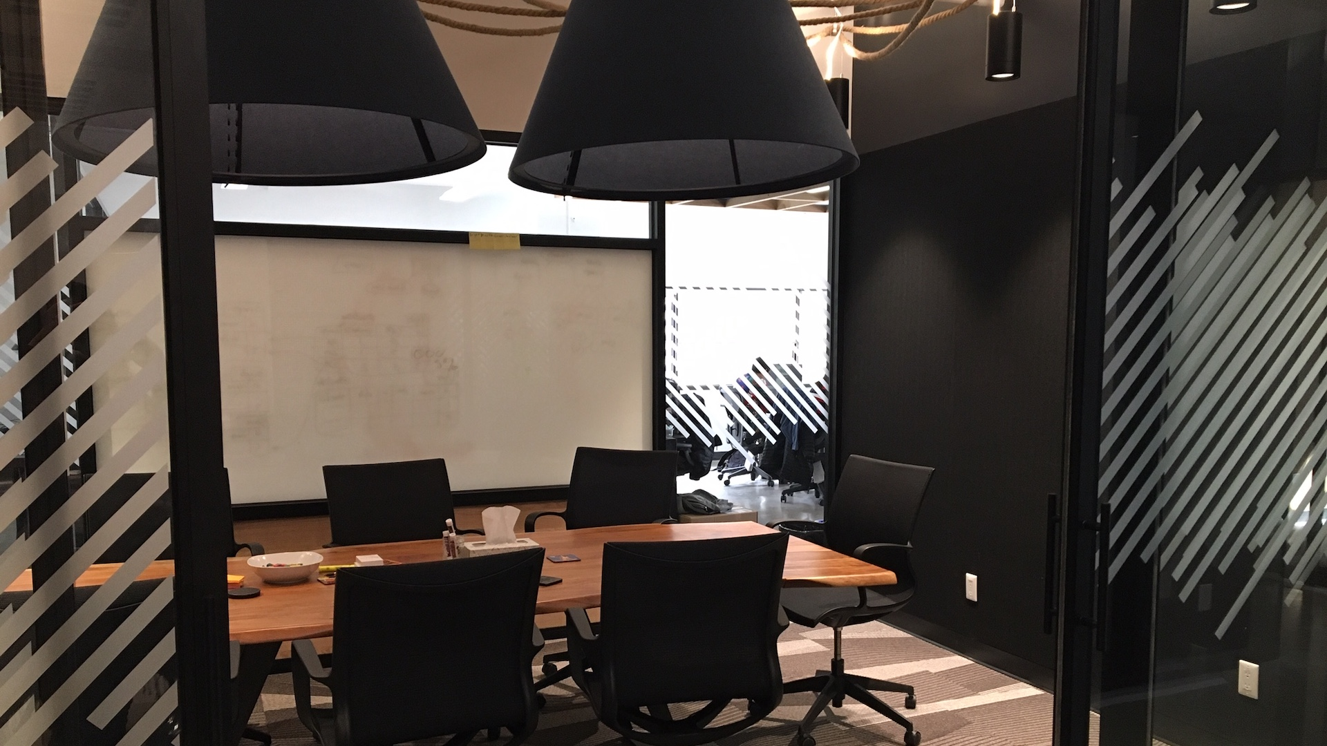 A photo of a Zeitspace meeting room with a table and whiteboards.