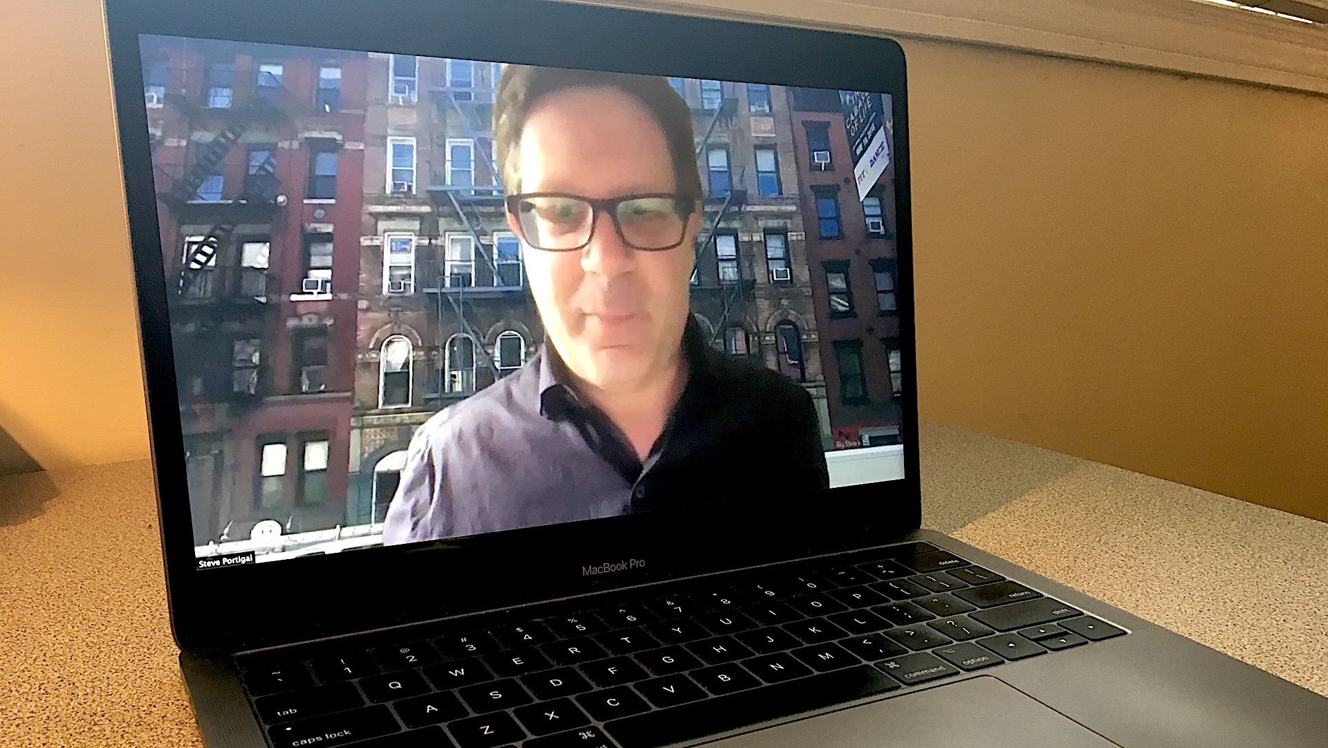 UX researcher Steve Portigal on a laptop screen.