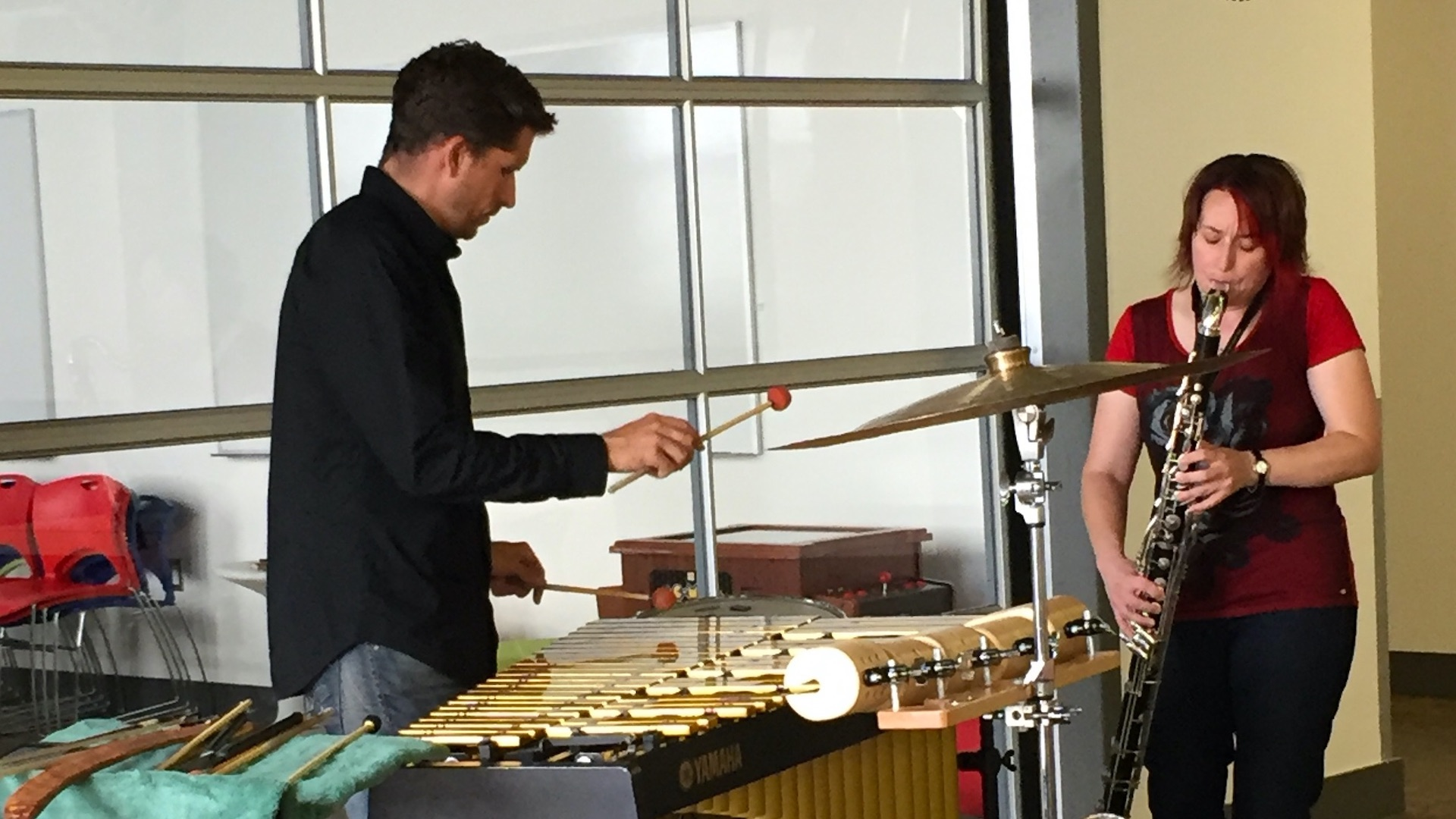 A man and woman playing musical instruments.